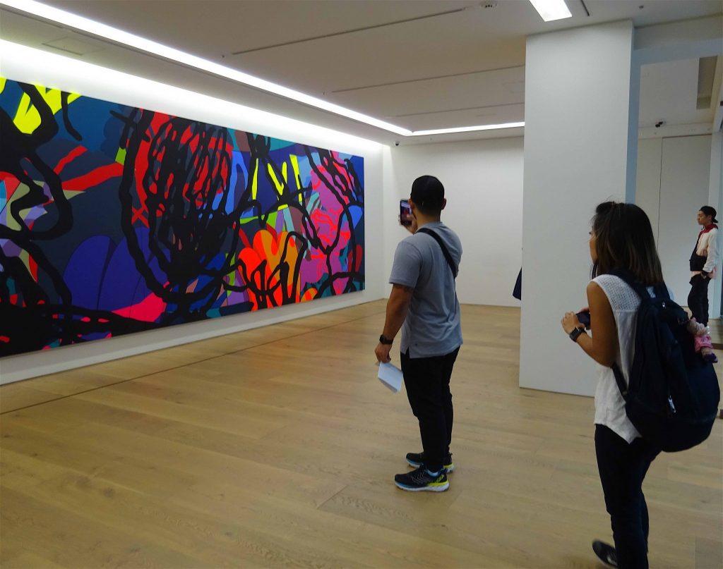 KAWS 「ACTIVITY TRAP」2017-2018, acrylic on canvas, 243.8 x 731.5 x 2.7 cm
