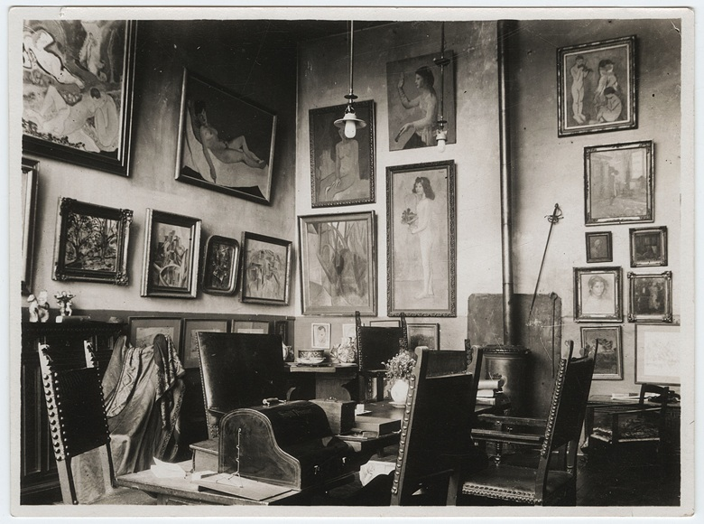 Gertrude Steins' Paris home, circa 1912-13. Picasso's Fillette à la corbeille fleurie, 1905, is to the left of the stove. Photo from the Gertrude Stein and Alice B. Toklas papers.