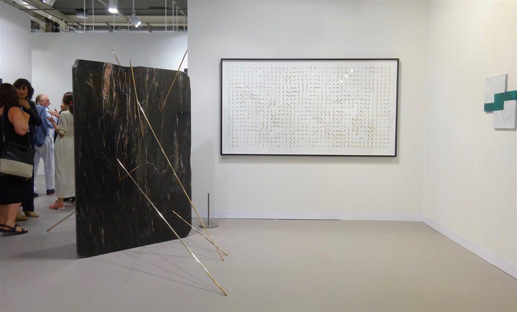 Alicja Kwade works, right wall Mary Heilmann @ 303 booth