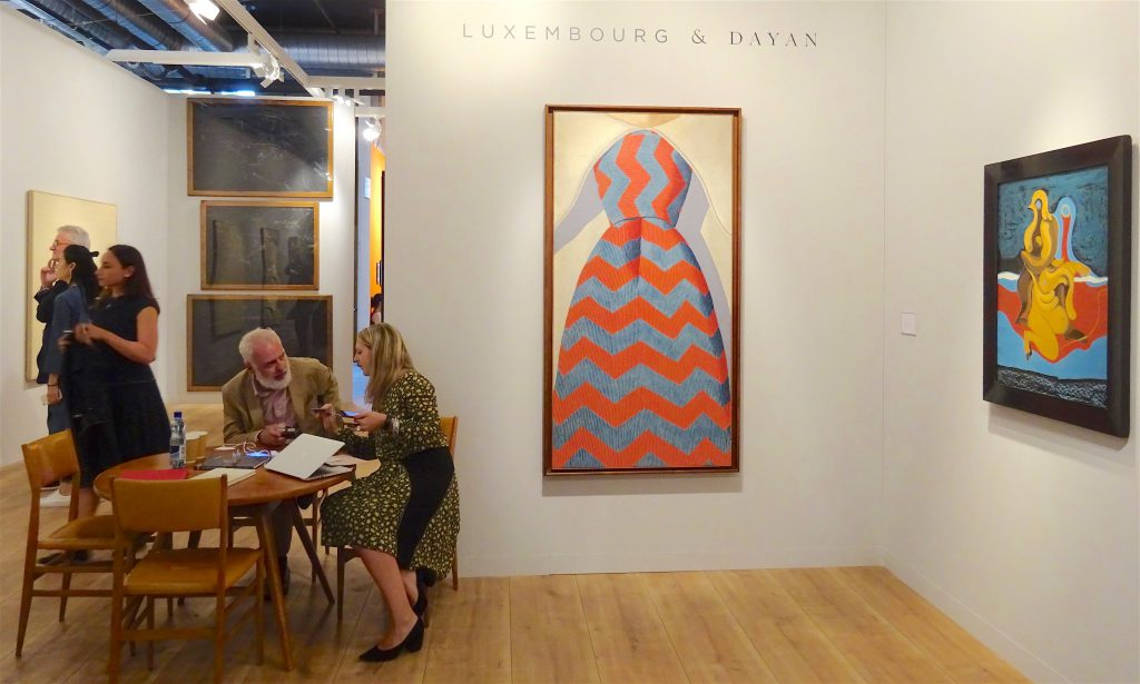 Curator Mr. Francesco Bonami sitting at the table, Luxembourg & Dayan booth