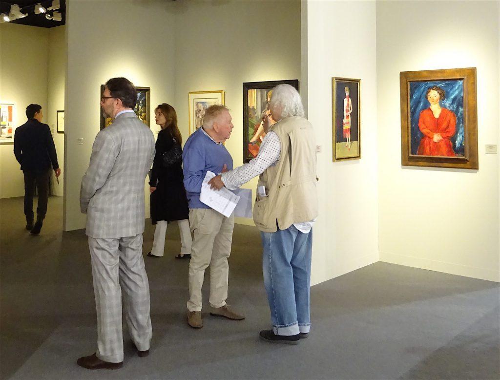 Gallery owner Richard Nagy, left, suit