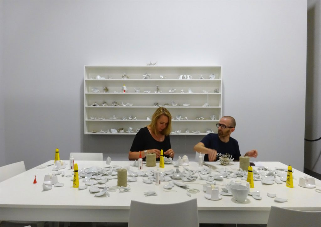 """Yoko Ono """"Mend Piece (Galerie Lelong version) 1966-2018, Table, chairs, shelving, ceramic, glue, tape, scissors, and twine; dimensions variable, UNLIMITED Galerie Lelong & Co."""