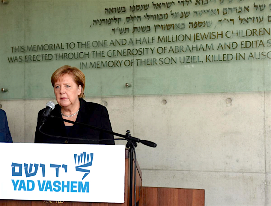 Chancellor Angela Merkel delivers a statement after signing the guest book at Yad Vashem World Holocaust Remembrance Center in Jerusalem October 2018