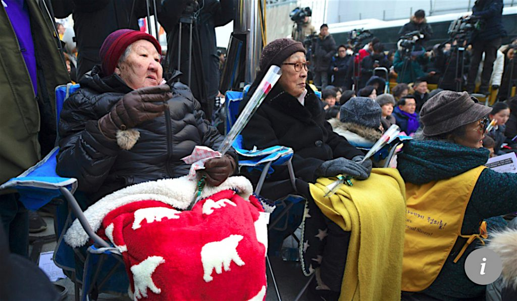 "Former ""comfort women"" Gil Won-ok (left) and Kim Bok-dong (centre) protest at the Japanese embassy in Seoul in 2016"