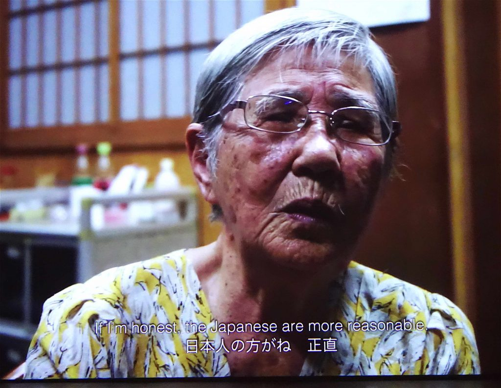 "DOKUYAMA Bontaro 毒山凡太朗 「君之代―斉唱―」""My anthem"" 2019、 一コマ"