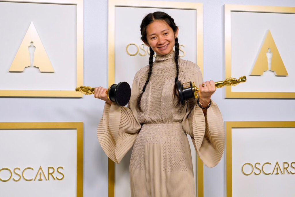 Chloé Zhao with her 2 Oscars
