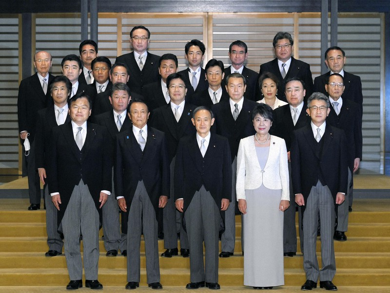 Japan's newly elected Prime Minister Yoshihide Suga, centre, front row, and his Cabinet members pose for a photo at the Imperial Palace in Tokyo on Sept. 16, 2020