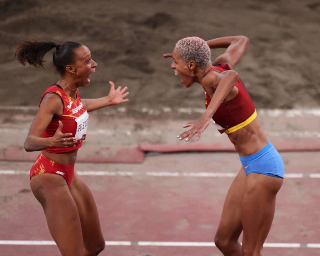 (Right) Yulimar Roja, women's triple jump, WR+Gold for Venezuela