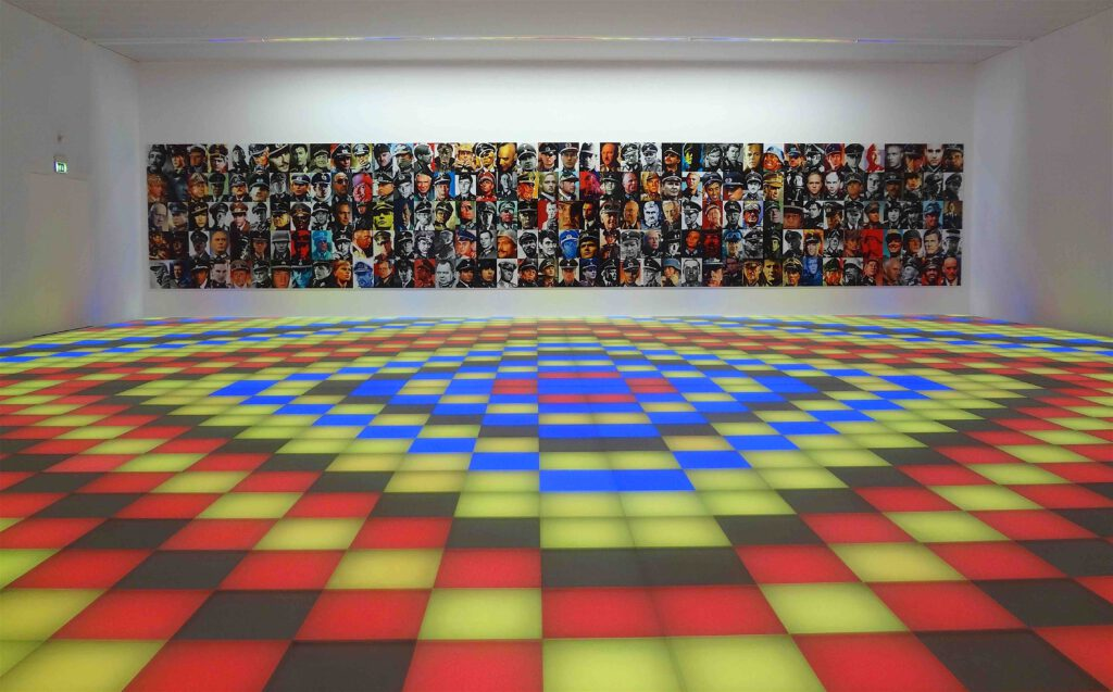 "Piotr Uklanski ""Untitled (Dancing Nazis)"" 2008, Plexiglas panels, coloured lightbulbs, raised floor structure, audio equipment and computer-controlled sound system"