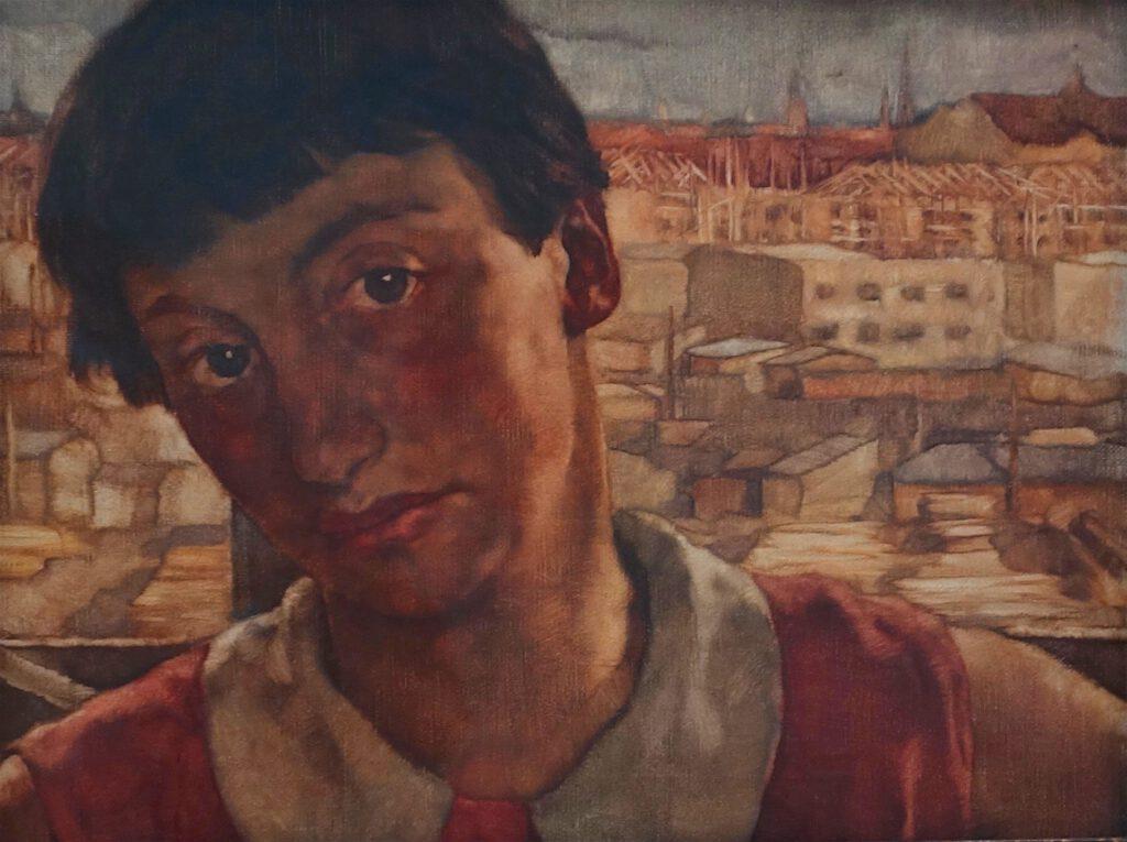 ロッテ・ラーゼルシュタイン「フリードリヒスルーハー通りのアトリエでの自画像」キャンバスに油彩、32 x 42 センチ、約1927年 (Berlinische Galerie)